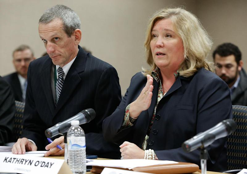 FILE - This Nov. 8, 2012 file photo shows Department of Children's Services commissioner Kate O'Day, right, during a budget hearing in Nashville, Tenn. Republican Gov. Bill Haslam announced on Tuesday, Feb. 5, 2013, that O'Day has resigned amid scrutiny of handling of death cases. (AP Photo/Mark Humphrey, File)