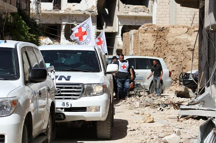 A truce brokered by the US and Russia appears to be holding on its first full day, but a key test of the deal will be whether warring parties allow relief to reach people in Syria's besieged areas (AFP Photo/Fadi Dirani)
