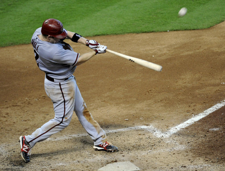 Arizona Diamondbacks' Aaron Hill connects for a home run, his second of the baseball game, against the Houston Astros in the eighth inning on Sunday, Aug. 19, 2012, in Houston. Arizona won 8-1. (AP Photo/Pat Sullivan)