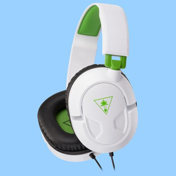 A white Turtle Beach Recon 50X headset with green accents.