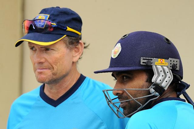 Sri Lanka's Mahela Jayawardene (right) speaks with coach Graham Ford during a practice session at the Sharjah International Cricket Stadium in Sharjah, in 2014 (AFP Photo/Ishara S.Kodikara)