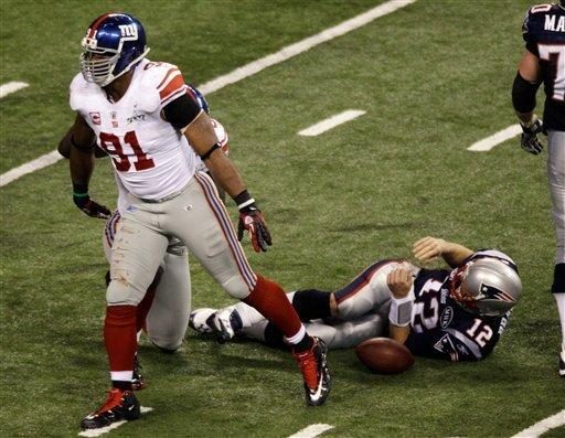 New York Giants defensive end Justin Tuck (91) reacts after sacking New England Patriots quarterback Tom Brady during the second half of the NFL Super Bowl XLVI football game, Sunday, Feb. 5, 2012, in Indianapolis. (AP Photo/Charlie Riedel)