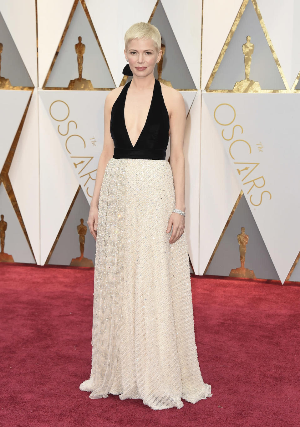 <p>Michelle Williams usually stands out on the red carpet in a bright color or interesting design. Yet for the 2017 Oscars, she didn't do either, instead choosing a subtle black and white halter gown from Louis Vuitton. <em>(Photo: Getty Images)</em> </p>
