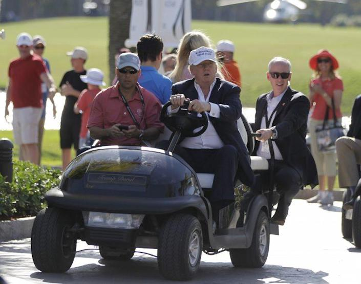 In this March 6, 2016, file photo, Donald Trump drives himself around a golf course to watch the final round of the Cadillac Championship golf tournament in Doral, Fla. (Photo: Luis Alvarez/AP)