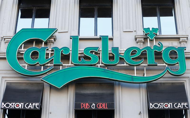 FILE PHOTO: A logo of Carlsberg beer is seen on the entrance of a pub in Brussels