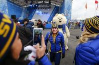 Members of Sweden's Olympic team pose with the Olympic mascot during a welcoming ceremony for the team in the Athletes Village at the Olympic Park ahead of the 2014 Winter Olympic Games in Sochi February 5, 2014. REUTERS/Shamil Zhumatov (RUSSIA - Tags: SPORT OLYMPICS)