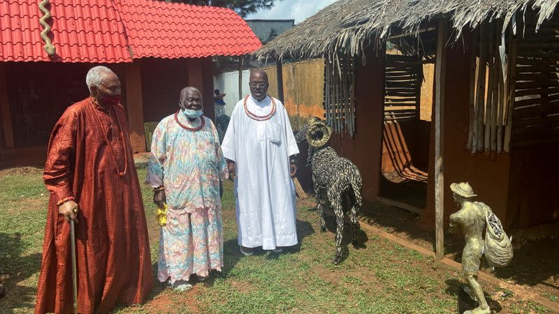FILE PHOTO: Iyase of Benin, Chief Sam Igbe holds a walking stick next to two other chiefs during the unveiling of Lucas Osarobo- Okoro's largest bronze work in Benin