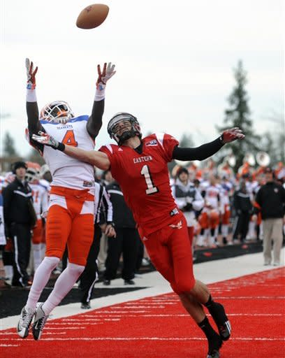 Sam Houston State cornerback Bookie Sneed (4) breaks up a pass for Eastern Washington receiver Brandon Kaufman during the first half of an FCS semifinal playoff NCAA college football game on Saturday, Dec. 15, 2012, in Cheney, Wash. (AP Photo/The Spokesman-Review, Tyler Tjomsland)