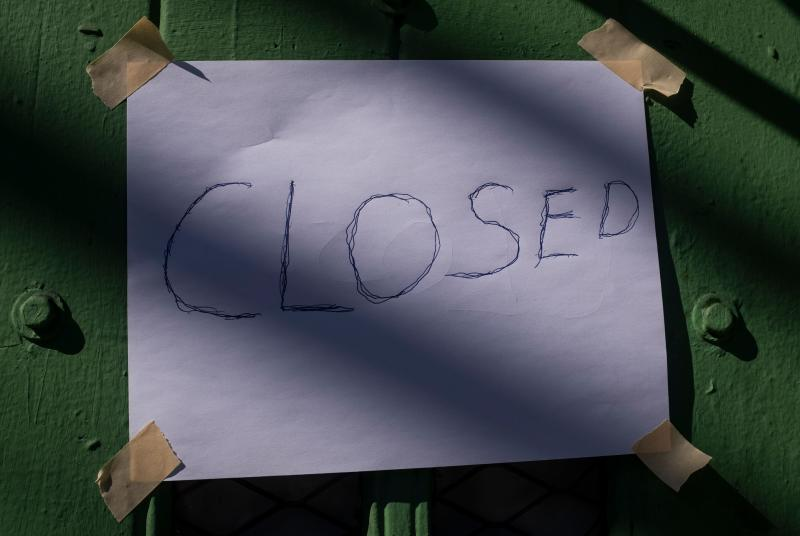 """A """"closed"""" sign is seen at a door of a Bar in March 18, 2020 in New York City. - The coronavirus outbreak has transformed the US virtually overnight from a place of boundless consumerism to one suddenly constrained by nesting and social distancing. (Photo by Johannes EISELE / AFP) (Photo by JOHANNES EISELE/AFP via Getty Images)"""