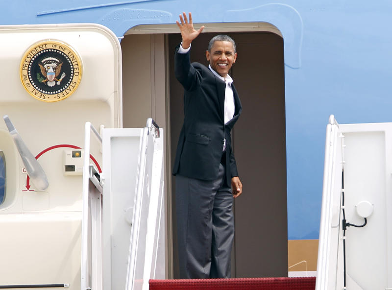 President Barack Obama waves from Air Force One before departing at Andrews Air Force Base, Md., on Saturday, Aug. 11, 2012, en route to Chicago. ( AP Photo/Jose Luis Magana)