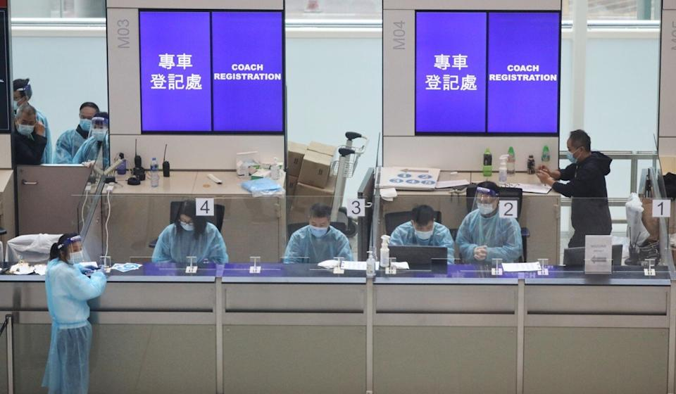 A counter at Hong Kong International Airport for arranging transport to designated quarantine hotels, a measure intended to prevent imported infections. Photo: Nora Tam