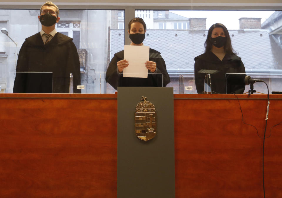 Judge Regina Antal, centre, delivers the verdict on the fate of the broadcaster Klubradio in Budapest, Tuesday, Feb. 9, 2021. One of Hungary's last remaining independent radio stations will be forced off the airwaves and limited to online broadcasts after a court upheld a decision by media regulators not to extend its broadcasting license. The court dismissed a challenge brought by Klubradio, a liberal-leaning commercial station broadcasting in Budapest. (AP Photo/Laszlo Balogh)