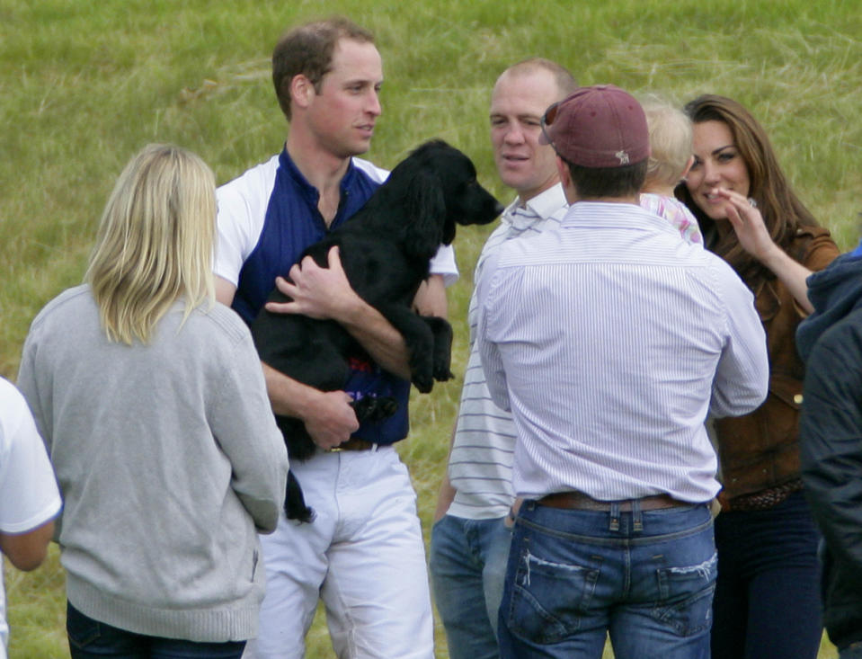 Prince William holds Lupo at a polo match