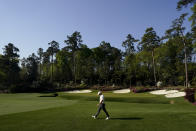 Rory McIlroy, of Northern Ireland, walks on the 14th hole during a practice round for the Masters golf tournament on Tuesday, April 6, 2021, in Augusta, Ga. (AP Photo/Charlie Riedel)