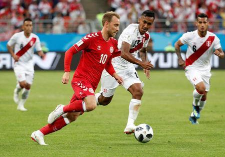 Soccer Football - World Cup - Group C - Peru vs Denmark - Mordovia Arena, Saransk, Russia - June 16, 2018 Denmark's Christian Eriksen in action with Peru's Renato Tapia REUTERS/Max Rossi
