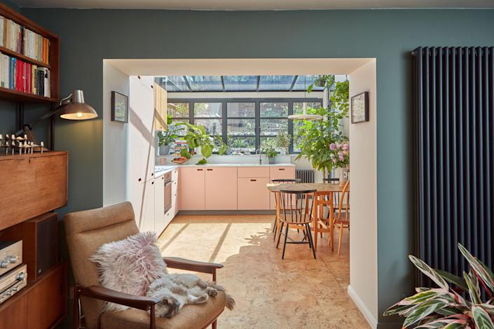 """<div class=""""caption""""> The kitchen and living room are now distinctly separate. </div>"""