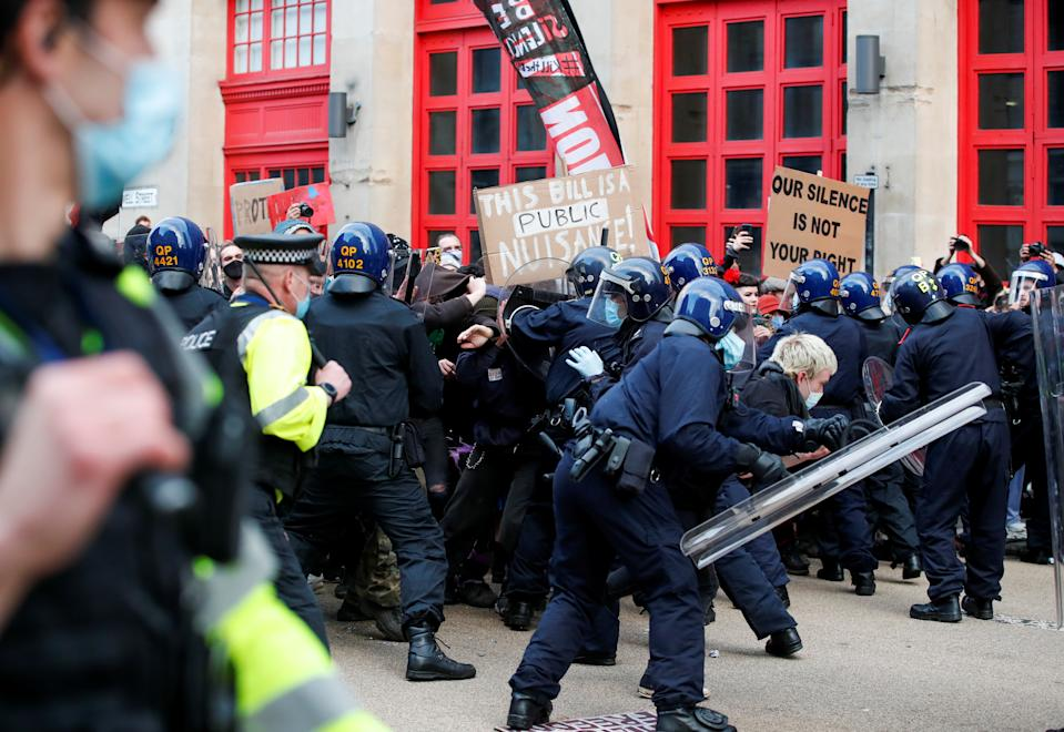 <p>Police officers control the crowd during a protest against a new proposed policing bill, in Bristol, Britain, March 21, 2021. REUTERS/Peter Cziborra</p>
