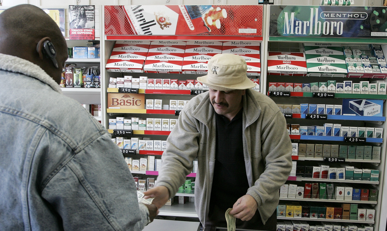 Shop owner Izzat Asfour sells a pack of cigarettes to a customer March 9, 2006 in San Francisco. (Photo: Justin Sullivan/Getty Images)