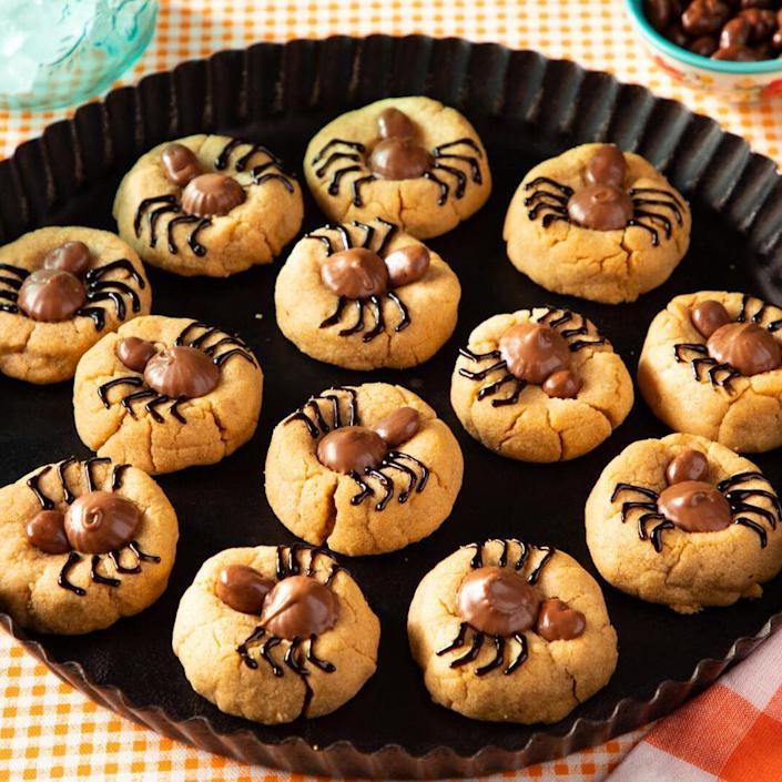 """<p>Baking these creepy, crawly treats is a fun <a href=""""https://www.thepioneerwoman.com/holidays-celebrations/g36743317/fun-halloween-activities/"""" rel=""""nofollow noopener"""" target=""""_blank"""" data-ylk=""""slk:Halloween activity"""" class=""""link rapid-noclick-resp"""">Halloween activity</a> for the whole family, but what's more? The candy-topped peanut butter cookies are delicious to eat too! </p><p><a href=""""https://www.thepioneerwoman.com/food-cooking/recipes/a37002555/spider-cookies-recipe/"""" rel=""""nofollow noopener"""" target=""""_blank"""" data-ylk=""""slk:Get the recipe."""" class=""""link rapid-noclick-resp""""><strong>Get the recipe.</strong></a></p>"""