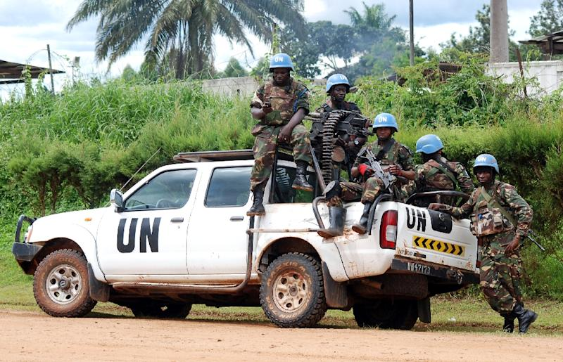 Members of the United Nations Organization Stabilization Mission in the Democratic Republic of Congo (MONUSCO) on the back of a UN truck on October 23, 2014 in Beni