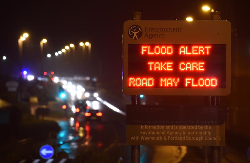 WEYMOUTH, UNITED KINGDOM - JANUARY 13: Environment Agency flood alert warning sign on the A354 road as Storm Brendan heads in on January 13, 2020 in Weymouth, United Kingdom. (Photo by Finnbarr Webster/Getty Images)