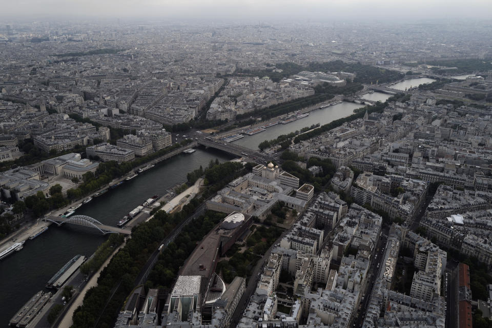 View from the third level and top of the Eiffel Tower of the Seine river and the north side of Paris during the opening up of the top floor of the Eiffel Tower, Wednesday, July 15, 2020 in Paris. The top floor of Paris' Eiffel Tower reopened today as the 19th century iron monument re-opened its first two floors on June 26 following its longest closure since World War II. (AP Photo/Francois Mori)