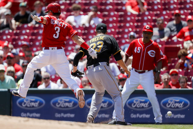 Cincinnati Reds' Scooter Gennett (3) reaches first on a fielding error by Pittsburgh Pirates starting pitcher Ivan Nova to first baseman David Freese (23) to load the bases in the third inning of a baseball game, Thursday, May 24, 2018, in Cincinnati. (AP Photo/John Minchillo)