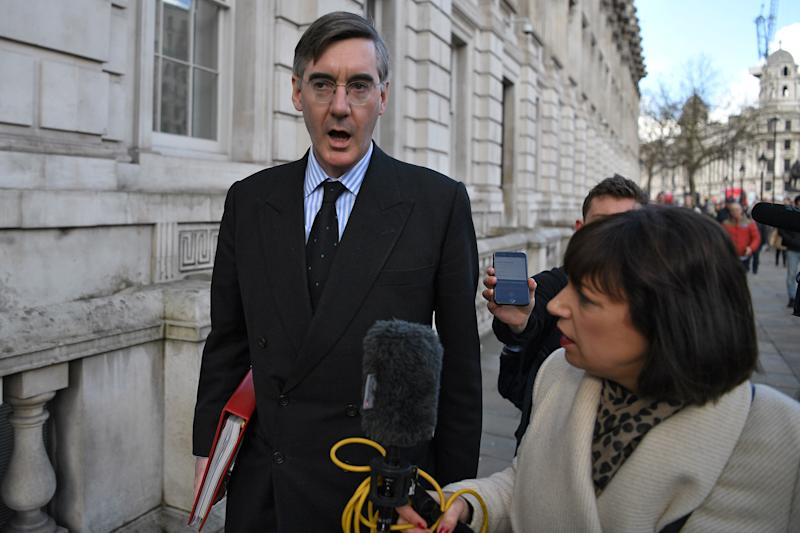 Britain's Leader of the House of Commons Jacob Rees-Mogg (L) is interviewed by Sky News journalist Beth Rigby as he leaves from the Cabinet Office on Whitehall in central London on March 2, 2020, ahead of an emergency COBRA meeting into UK's developing coronavirus COVID-19 situation. - Britain's Prime Minister Prime Minister will on Monday Chair an emergency COBRA meeting on the coronavirus outbreak, after the number of confirmed cases of COVID-19 in the United Kingdom rose to 36. (Photo by DANIEL LEAL-OLIVAS / AFP) (Photo by DANIEL LEAL-OLIVAS/AFP via Getty Images)