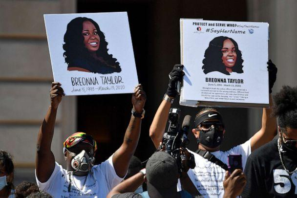 PHOTO: Signs are held up showing Breonna Taylor during a rally in her honor on the steps of the Kentucky State Capitol in Frankfort, Ky., June 25, 2020. (Timothy D. Easley/AP)