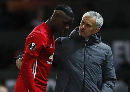 Britain Football Soccer - Manchester United v FC Rostov - Europa League Round of 16 Second Leg - Old Trafford, Manchester, England - 16/3/17 Manchester United's Paul Pogba walks off to be substituted after sustaining an injury as manager Jose Mourinho looks on Action Images via Reuters / Jason Cairnduff Livepic