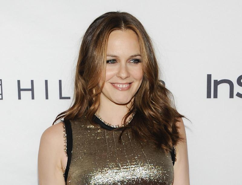"""FILE - This Sept. 13, 2011 file photo shows actress Alicia Silverstone attending the Instyle and Hollywood Foreign Press party at the Windsor Arms Hotel during the Toronto International Film Festival in Toronto.  Silverstone is joining the cast of the upcoming Broadway comedy """"The Performers."""" Previews begin Oct. 23 and opening night is  Nov.14 at the Longacre Theatre in New York. (AP Photo/Evan Agostini, file)"""