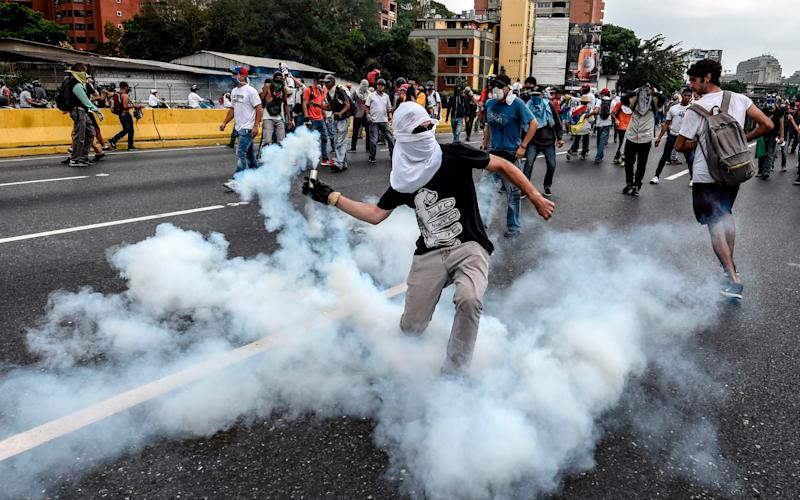 Demonstrators clash with riot police  - AFP