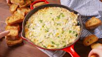 """<p>Your party guests will eat this up in seconds.</p><p>Get the recipe from <a href=""""https://www.delish.com/cooking/recipe-ideas/recipes/a49883/crab-artichoke-dip-recipe/"""" rel=""""nofollow noopener"""" target=""""_blank"""" data-ylk=""""slk:Delish"""" class=""""link rapid-noclick-resp"""">Delish</a>.</p>"""