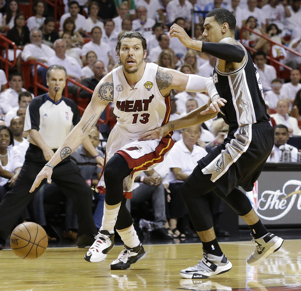 San Antonio Spurs shooting guard Danny Green (4) defends Miami Heat shooting guard Mike Miller (13) during the first half of Game 6 of the NBA Finals basketball game, Tuesday, June 18, 2013 in Miami. (AP Photo/Lynne Sladky)