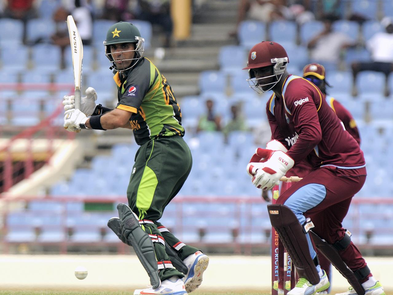 Pakistan batsman Misbah-ul-Haq cuts on his way to a half century during the 3rd ODI West Indies v Pakistan at Beausejour Cricket Ground in Gros Islet on July 19, 2013. The wicket-keeper is Johnson Charles. Pakistan made 229-6 off their 50 overs in the third one-day international against the West Indies.    AFP PHOTO/Randy Brooks        (Photo credit should read RANDY BROOKS/AFP/Getty Images)