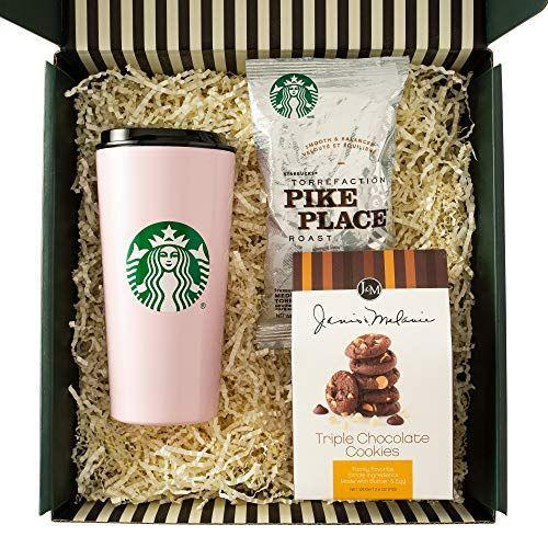 """<p><strong>Starbucks</strong></p><p>amazon.com</p><p><strong>$29.99</strong></p><p><a href=""""https://www.amazon.com/dp/B08KYKPXQ2?tag=syn-yahoo-20&ascsubtag=%5Bartid%7C10055.g.19694294%5Bsrc%7Cyahoo-us"""" rel=""""nofollow noopener"""" target=""""_blank"""" data-ylk=""""slk:Shop Now"""" class=""""link rapid-noclick-resp"""">Shop Now</a></p><p>Starbucks coffee is the way to her heart. When you throw in a pretty pink travel mug and a box of chocolate cookies, it goes without saying that she'll have a very happy Mother's day. </p>"""