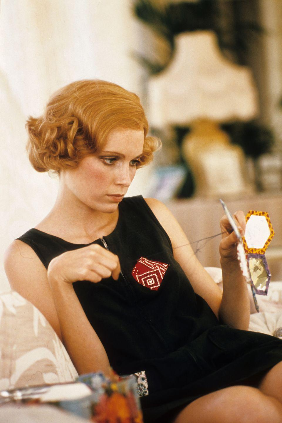 """<p>In-between scenes of <em>The Great Gatsby</em>, Farrow needlepoints on-set. Although the actress was renowned for her role in the film, the part of Daisy was first offered to Natalie Wood, <a href=""""https://www.imdb.com/title/tt0071577/trivia#:~:text=Natalie%20Wood%20was%20offered%20the,idea%20and%20lost%20her%20chance.&text=Sam%20Waterston%20is%20a%20graduate,as%20his%20character%20Nick%20Carraway."""" rel=""""nofollow noopener"""" target=""""_blank"""" data-ylk=""""slk:who turned it down"""" class=""""link rapid-noclick-resp"""">who turned it down</a>.</p>"""