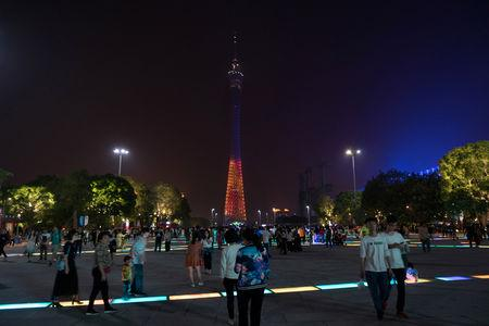 Guangzhou TV Tower is seen with the light being switched off for Earth Hour in Guangzhou, Guangdong