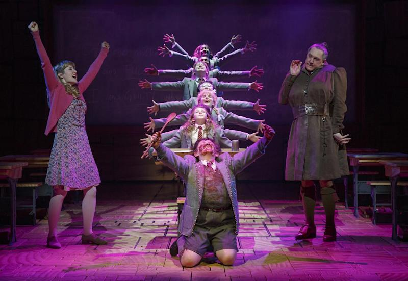 "This theater publicity image released by Boneau/Bryan-Brown shows the cast of ""Matilda The Musical,"" including Bertie Carvel, right, and Lauren Ward, left, during a performance in New York. (AP Photo/Boneau/Bryan-Brown, Joan Marcus)"