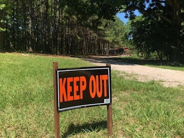 """A """"KEEP OUT"""" sign freshly put in the grass outside of the Murdaugh home in Colleton County."""