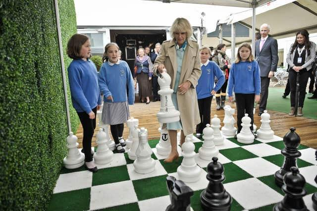 The Duchess of Cornwall plays a game of outdoor chess at the Hay Festival in 2013