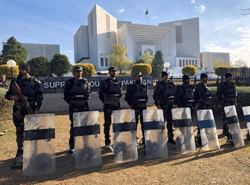 FILE PHOTO: Paramilitary soldiers stand guard outside the Supreme Court building in Islamabad