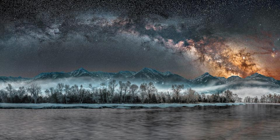 "According to NWF: ""To me, the Milky Way is one of the most beautiful things in the sky,"" says astral photographer Jake Mosher. ""And if I can frame it over something as beautiful as the Yellowstone River with fog, people will gain a whole new idea of a place they may know during the day but have never seen at night."" For this panorama, Mosher spent two predawn hours in the bitter cold, alone but for the calls of owls and geese. ""Despite today's bad news and division,"" he says, ""there's still magic all around us."" JAKE MOSHER, 2020 National Wildlife® Photo Contest"