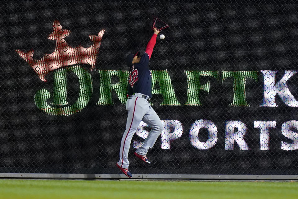 Washington Nationals right fielder Juan Soto cannot reach a double by Philadelphia Phillies' Rhys Hoskins during the ninth inning of a baseball game, Friday, June 4, 2021, in Philadelphia. (AP Photo/Matt Slocum)