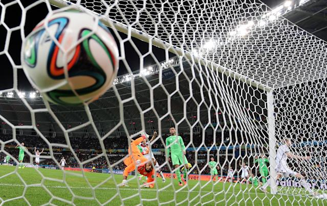 FILE - In this June 30, 2014 file photo, Germany's Andre Schuerrle, right, scores the opening goal during the World Cup round of 16 soccer match between Germany and Algeria at the Estadio Beira-Rio in Porto Alegre, Brazil. Schuerrle provided one of the most subtle of the top goals with his heel, but it was the one that finally gave Germany the lead in extra time against Algeria. (AP Photo/Frank Augstein, File)