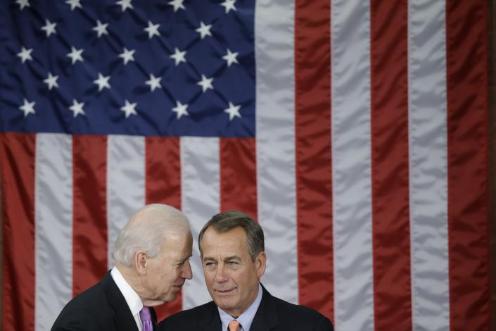 FILE - In this Feb. 12, 2013, file photo Vice President Joe Biden talks with House Speaker John Boehner of Ohio before President Barack Obama's State of the Union address during a joint session of Congress on Capitol Hill in Washington. (AP Photo/Pablo Martinez Monsivais, File)