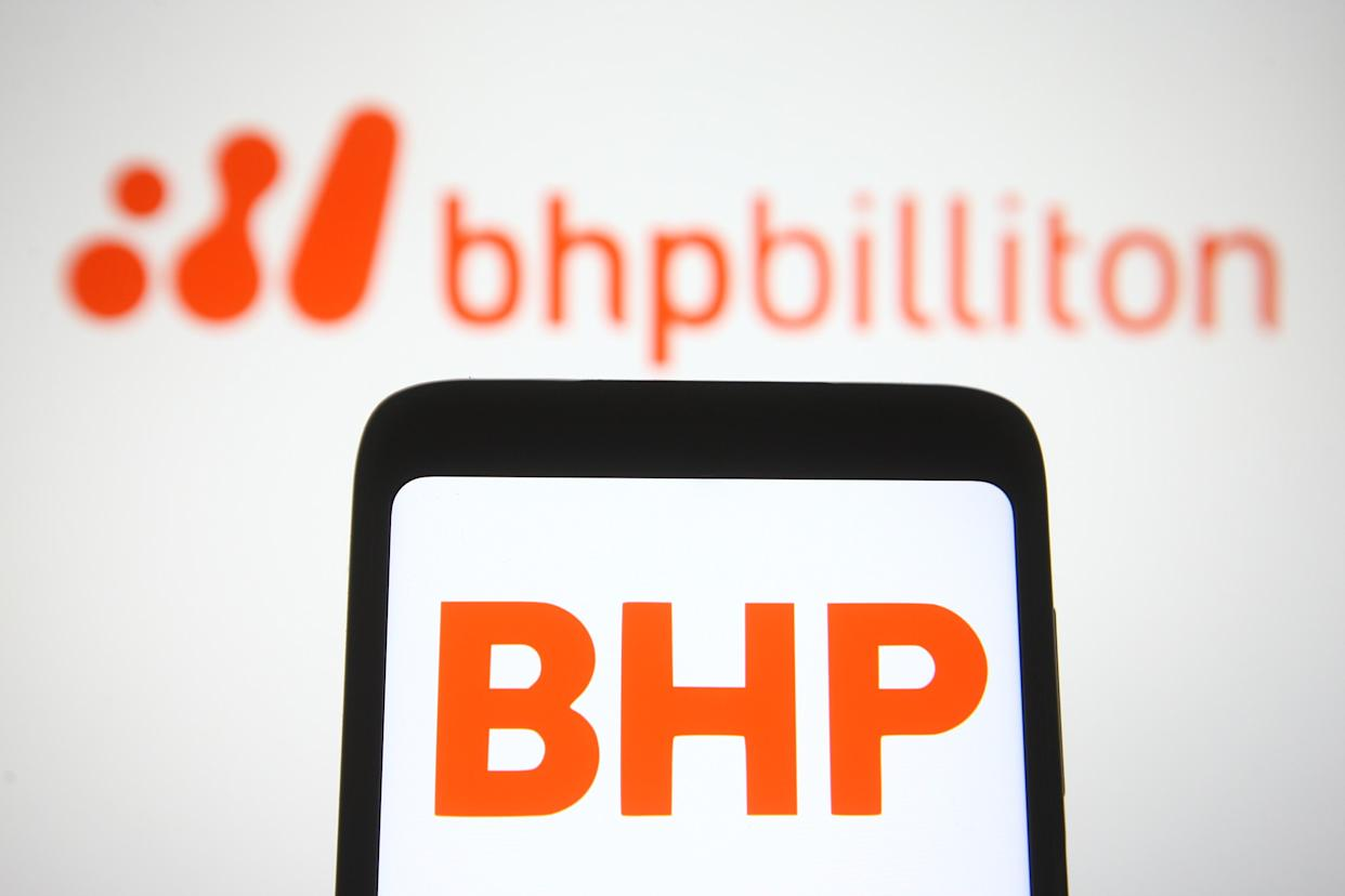 UKRAINE - 2021/04/30: In this photo illustration, BHP logo of a multinational mining, metals and petroleum company is seen displayed on a smartphone in front of BHP Billiton logo. (Photo Illustration by Pavlo Gonchar/SOPA Images/LightRocket via Getty Images)
