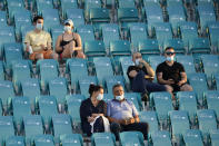 Socially distanced fans attend a match between Sebastian Korda and Radu Albot, of Moldova, during the Miami Open tennis tournament Thursday, March 25, 2021, in Miami Gardens, Fla. (AP Photo/Wilfredo Lee)