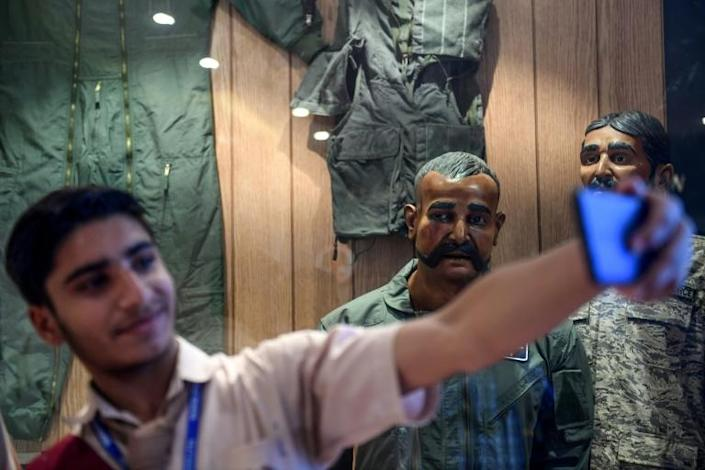 A Pakistan student in Karachi takes a selfie in front of the statue of Indian pilot Wing Commander Abhinandan Varthaman who was shot down over Kashmir earlier this year (AFP Photo/Asif HASSAN)