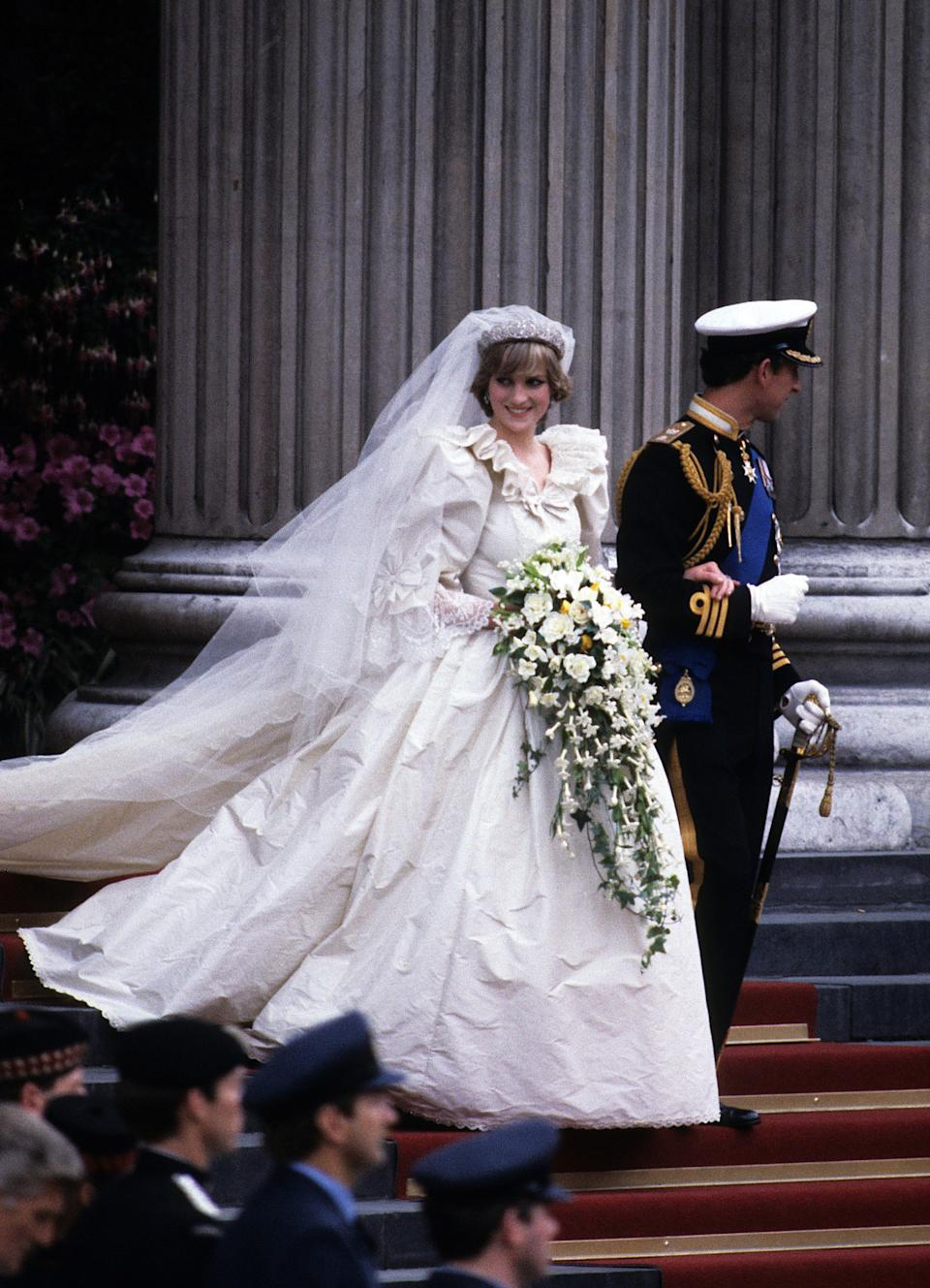 LONDON, ENGLAND - JULY 29: Prince Charles, Prince of Wales and Diana, Princess of Wales, wearing a wedding dress designed by David and Elizabeth Emanuel and the Spencer family Tiara, leave St. Paul's Cathedral following their wedding on July 29, 1981 in London, England. (Photo by Anwar Hussein/Getty Images)